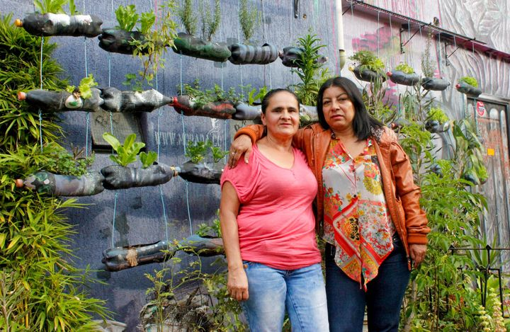 "Women Walking for Truth members Blanca Nidia Perez Botero (right) and Luz Elena Galeano Laverde (left) outside of ""La Casa Mo"