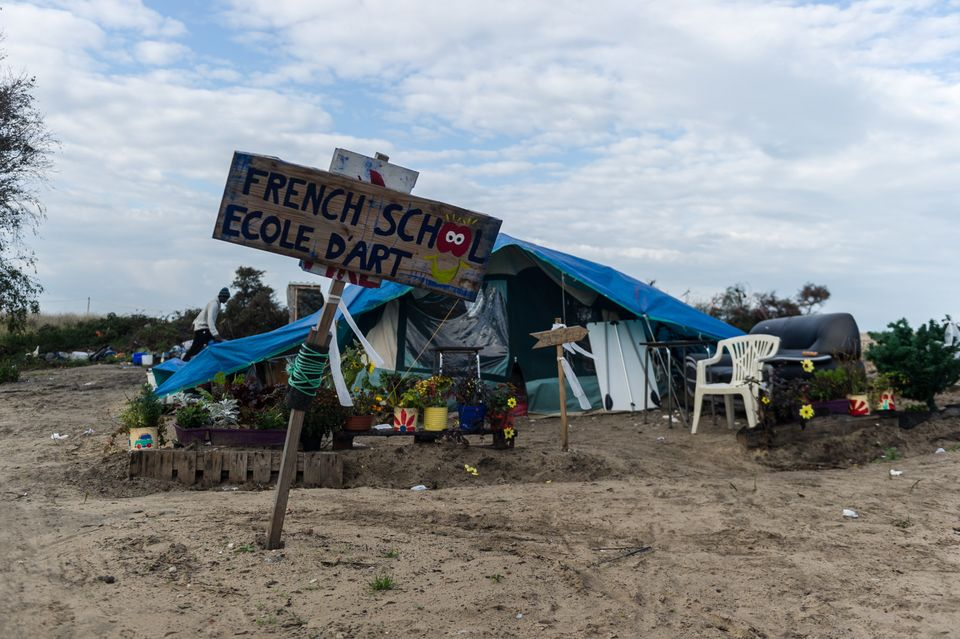 A handmade sign advertises anart school in the Calais Jungle on Oct. 16,