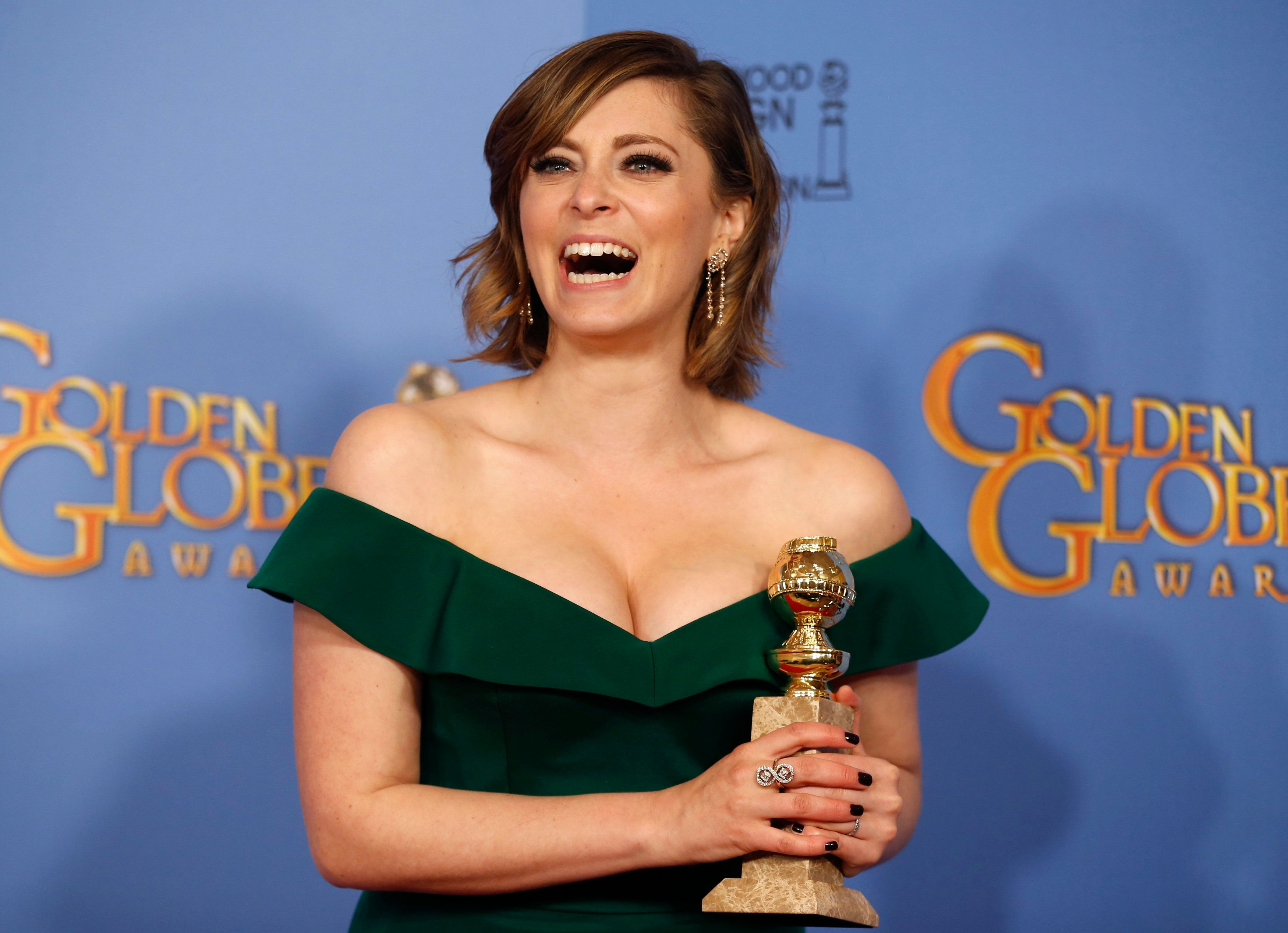 "Rachel Bloom poses with her award for Best Performance by an Actress in a Television Series - Musical or Comedy for her role in ""Crazy Ex-Girlfriend"" backstage at the 73rd Golden Globe Awards in Beverly Hills, California January 10, 2016.  REUTERS/Lucy Nicholson"