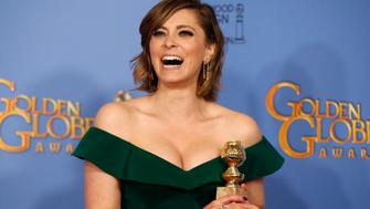 """Rachel Bloom poses with her award for Best Performance by an Actress in a Television Series - Musical or Comedy for her role in """"Crazy Ex-Girlfriend"""" backstage at the 73rd Golden Globe Awards in Beverly Hills, California January 10, 2016.  REUTERS/Lucy Nicholson"""