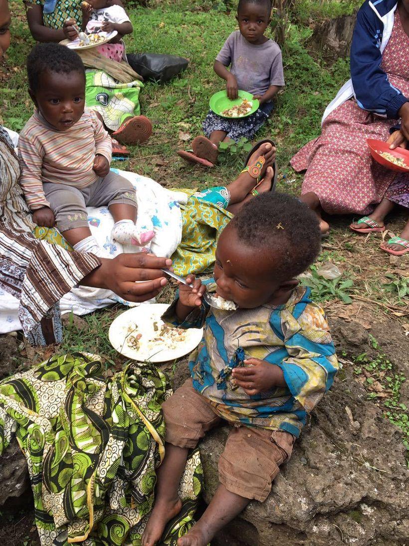 Children in Kigali, Rwanda eating micronutrient-fortified foods.
