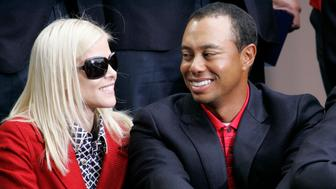 FILE - In this Oct. 11, 2009, file photo, United States team player Tiger Woods, right, is joined by wife, Elin Nordegren, at the closing ceremonies for the Presidents Cup in San Francisco, Calif. June 1, 1996, file photo. (AP Photo/Scot Tucker, File)
