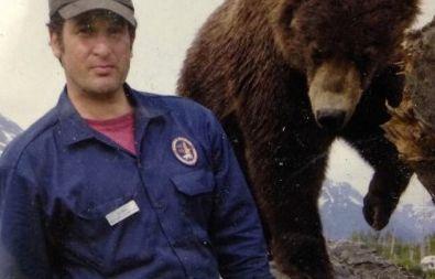 Dr. Jordan Schaul with a Kodiak brown bear cub
