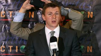 WASHINGTON, DC - SEPTEMBER 01:  Conservative undercover journalist James O'Keefe (L) is photographed by Project Veritas Action Senior Communications Strategist Stephen Gordon during a news conference at the National Press Club September 1, 2015 in Washington, DC. O'Keefe released a video of that accuses the Democratic frontrunner Hillary Clinton's director of marketing and FEC compliance director of breaking the law by allowing a Canadian tourist to buy $75 of campaign swag using the Project Veritas Action journalist as a straw purchaser. O'Keefe promised that people will resign from their jobs as his 'Army of Exposers' record and release more undercover videos during the 2016 campaign.  (Photo by Chip Somodevilla/Getty Images)