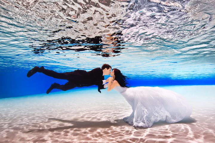 """""""For me, it's just the weirdest thing having shoes and socks on and a suit in the pool,"""" the groom said."""