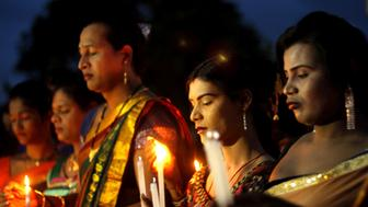 Members of the transgender community holds candle lights as they pray for died soldiers in the Uri sector of Jammu & Kashmir by the Pakistan militants attack in Bhubaneswar, India on 21 September 2016.  (Photo by STR/NurPhoto via Getty Images)