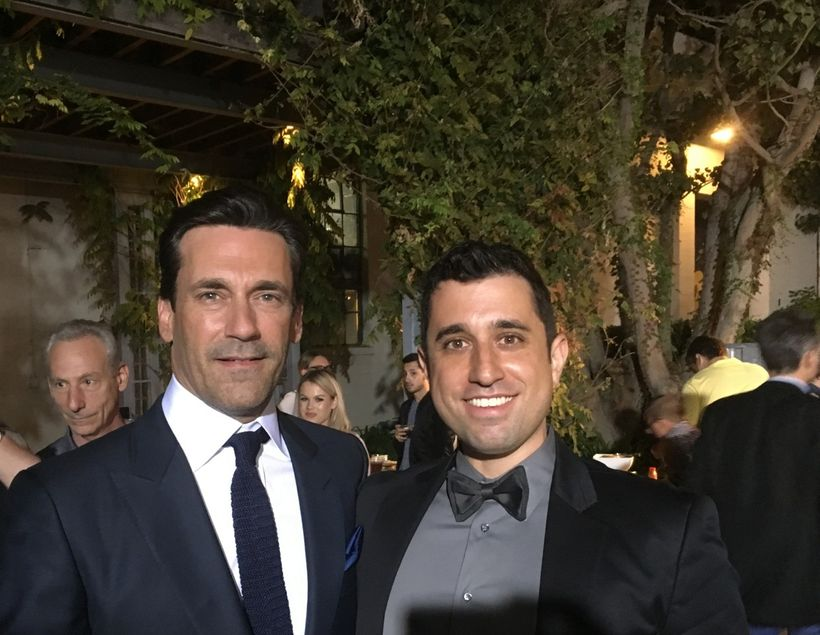 Jon Hamm (star of Keeping Up With the Joneses) poses with Jake Monaco at the movie's premiere