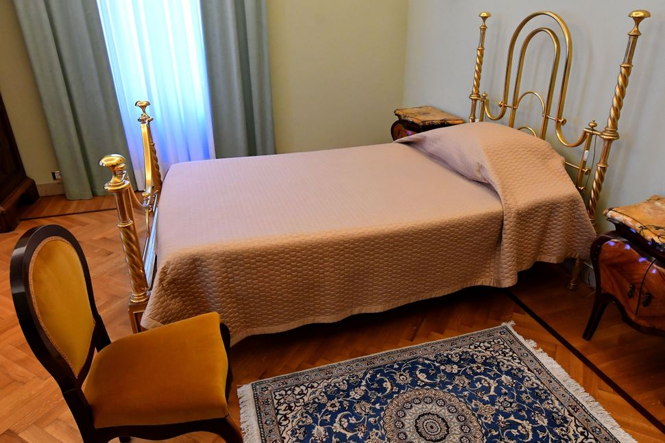 Visitors to the estate geta rare glimpseof the bed where Pope Pius XII and Pope Paul VI died and where John Paul