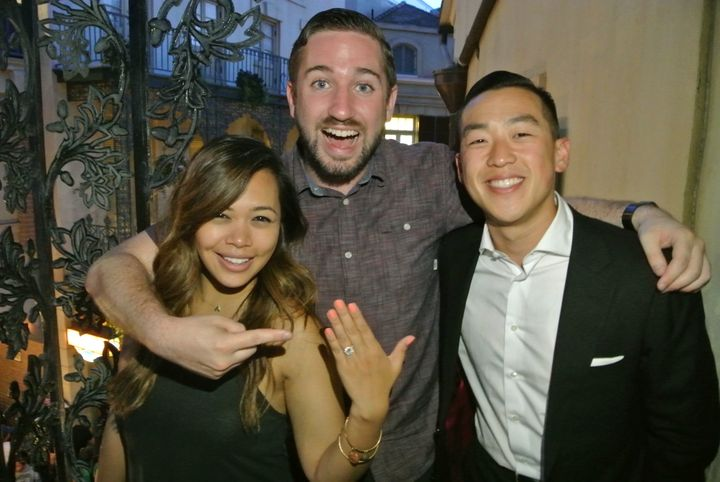 The couple posing with Tim, who helped orchestrate the proposal.