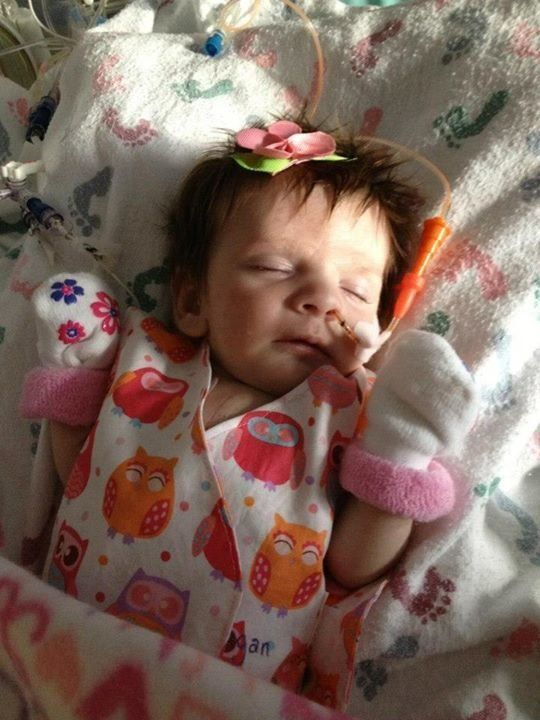 Teagan, then 1 month old, wearing a Gracie's Gown in September 2012. Teagan was diagnosed with