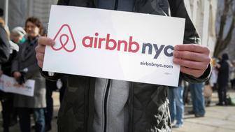 "Supporters of Airbnb stand during a rally before a hearing called ""Short Term Rentals: Stimulating the Economy or Destabilizing Neighborhoods?"" at City Hall in New York, U.S. on January 20, 2015.   REUTERS/Shannon Stapleton/File Photo"