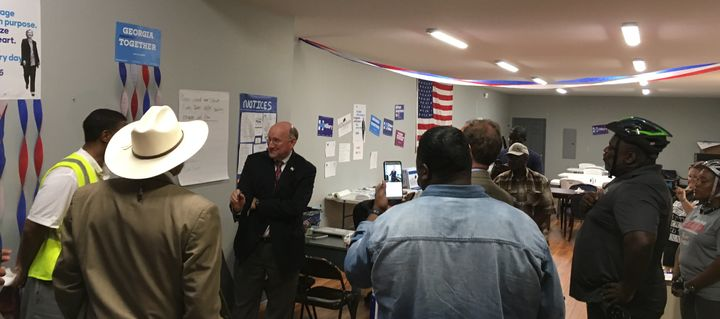 Georgia Democratic Party Chairman DuBose Porter gives volunteers a pep talk during a visit to the Macon-Bibb County Clinton-K