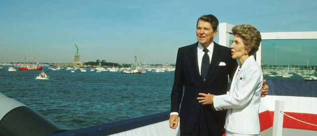 President Ronald Reagan stands with his wife Nancy during the Statue of Liberty's centennial celebration...