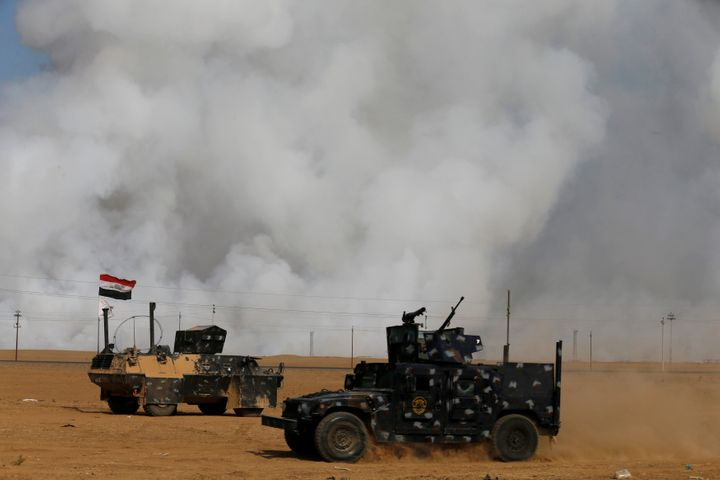 Smoke rises from a sulfur plant south of Mosul after ISIS militants set it on fire, releasing toxic smoke inthe area Fr