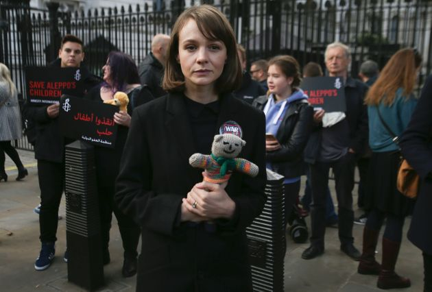 British actress Carey Mulligan holds a teddy bear as she joins demonstrators in a rally calling on the...