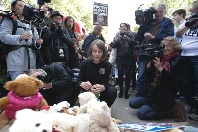 Carey Mulligan (C) is surrounded by media as she joins demonstrators and places a teddy bear outside...