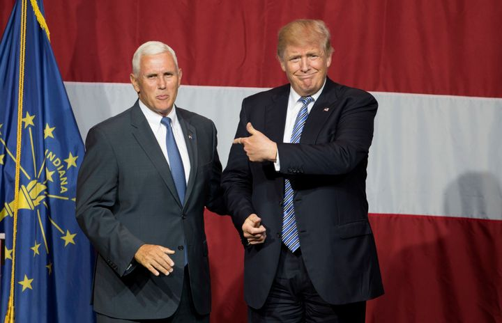 Republican presidential nomineeDonald Trump (R) and Indiana Governor Mike Pence (L) take the stage during a campaign ra
