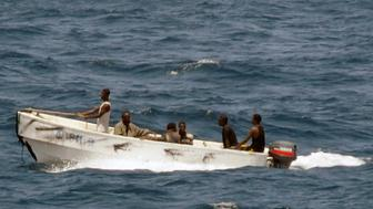 Pirates leave the merchant vessel MV Faina (not shown) for the Somali shore, while under observation by a U.S. Navy ship, in this picture taken on October 8, 2008 and released October 9. The NATO military alliance agreed on Thursday to join anti-piracy operations off Somalia, and a Japanese tanker was released after a $1.6 million ransom payment, officials said. REUTERS/Jason R. Zalasky/U.S. Navy/Handout (SOMALIA).  FOR EDITORIAL USE ONLY. NOT FOR SALE FOR MARKETING OR ADVERTISING CAMPAIGNS.