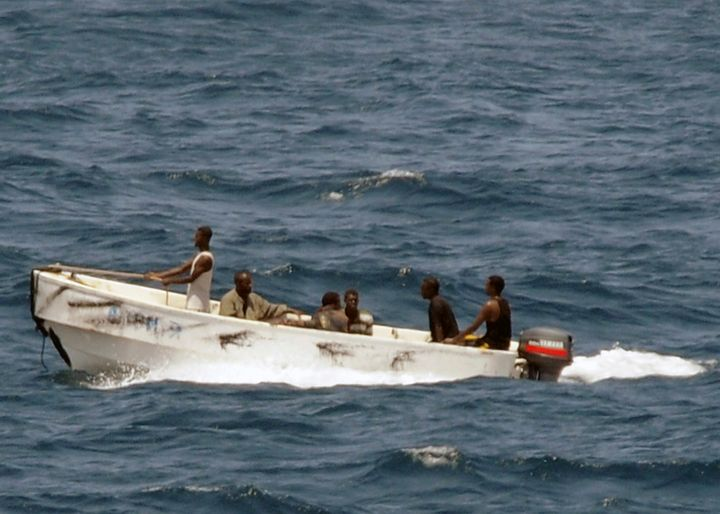 Pictured here, pirates head toward the Somali shore in 2008. Somali pirates recently released 26 Asian sailors held