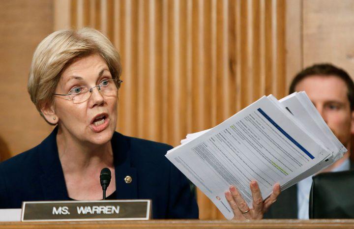 Elizabeth Warren shows companydocuments to Wells Fargo CEO John Stumpf during his testimony before a Senate Banking Com