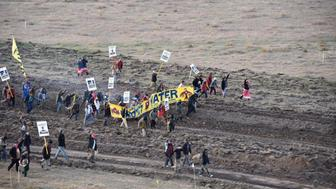 Protester gather near a pipeline being built by a group of companies led by Energy Transfer Partners LP at a construction site in North Dakota before being confronted by police October 22, 2016,  Photo courtesy Morton County Sheriff's Office/Handout via REUTERS ATTENTION EDITORS - THIS IMAGE WAS PROVIDED BY A THIRD PARTY. EDITORIAL USE ONLY