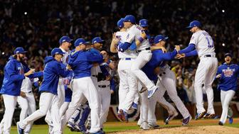 CHICAGO, IL - OCTOBER 22:  The Chicago Cubs celebrate defeating the Los Angeles Dodgers 5-0 in game six of the National League Championship Series to advance to the World Series against the Cleveland Indians at Wrigley Field on October 22, 2016 in Chicago, Illinois.  (Photo by Jamie Squire/Getty Images)