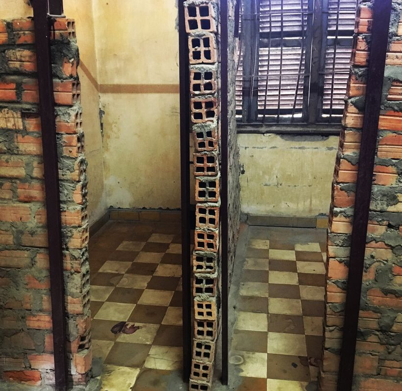 Blood still stains the floors of this Khmer Rouge torture facility in Phnom Penh. Only a recent memory, the genocide that vic