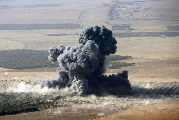 Smoke rises at Islamic State militants' positions in the town of Naweran, near Mosul, Iraq, October 23,