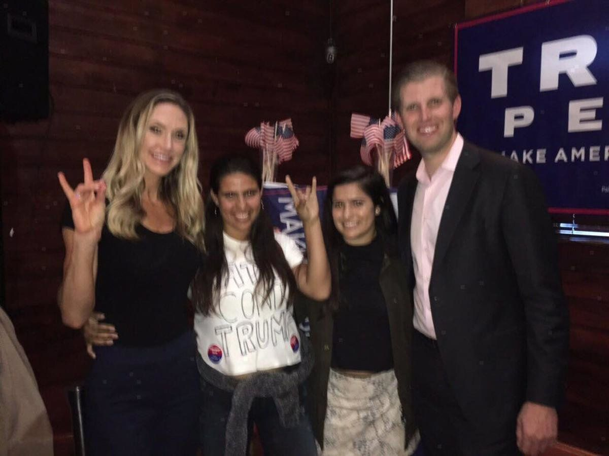 Sisters Annie Cardelle,23, and Ceci Cardelle, 17, pose for a photo with Donald Trump's son Eric and his wife, Lara.