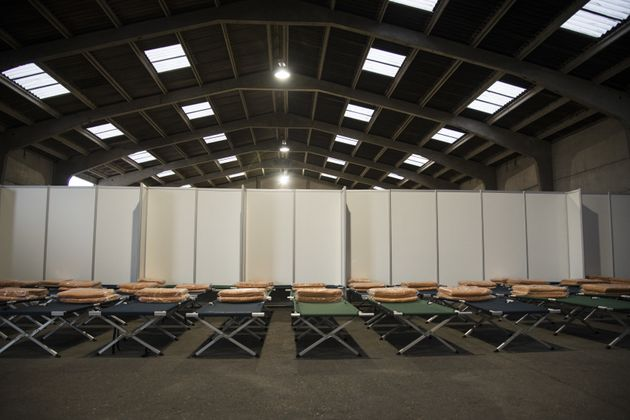 A view from inside a hangar which will temporarily accommodate refugees before they dispatched varied...