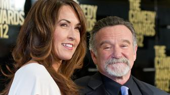 NEW YORK, NY - APRIL 28:  Susan Schneider (L) and comedian Robin Williams attend The Comedy Awards 2012 at Hammerstein Ballroom on April 28, 2012 in New York City.  (Photo by Gilbert Carrasquillo/FilmMagic)