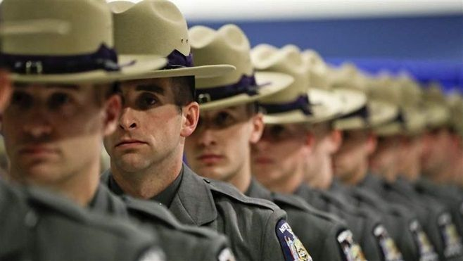 Graduating New York State Police officers line up during a ceremony in Albany. State police often leave the force for higher-