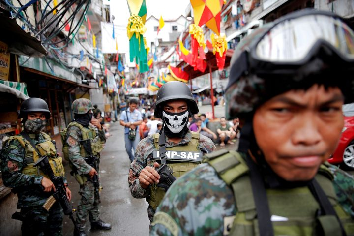 Armed security forces take a part in a drug raid, in Manila, Philippines, October 7, 2016.