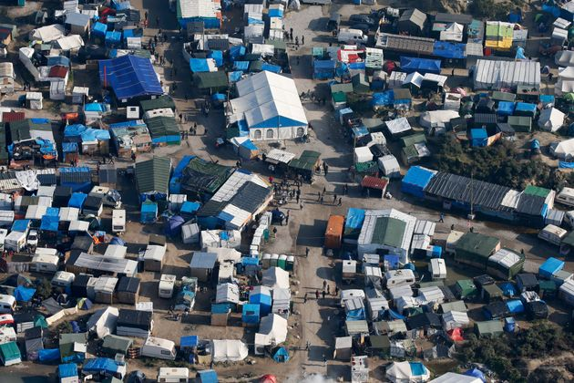An aerial view shows tents and makeshift shelters in'The Jungle' camp at