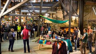 SEATTLE, WA - OCTOBER 27:  REI Seattle flagship store employees gather after news that all 143 stores will close on Black Friday and the specialty outdoor retailer will pay all 12,000 employees to take day as part of #OptOutside initiative on October 27, 2015 in Seattle, Washington.  (Photo by Suzi Pratt/Getty Images for REI)