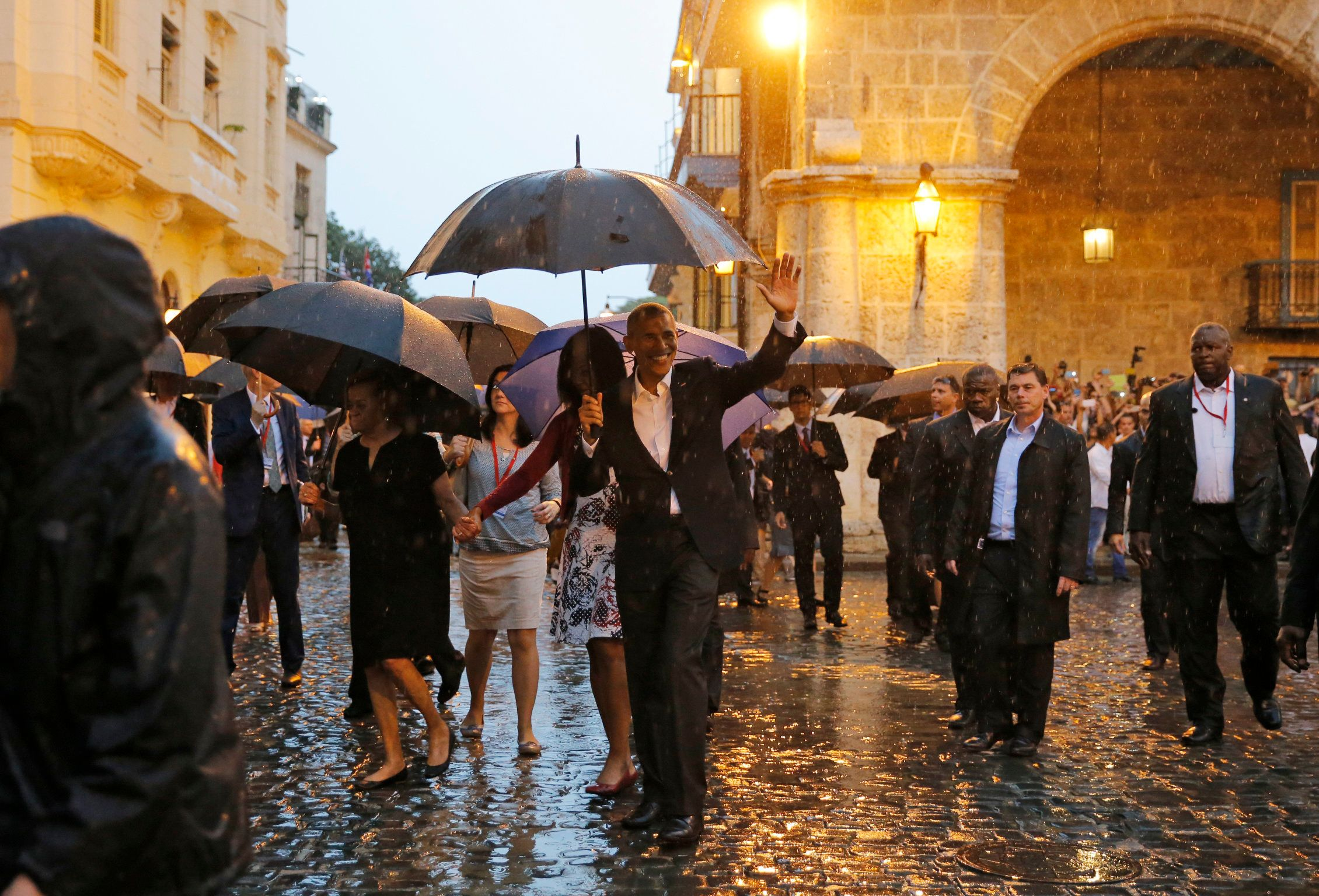 U.S. President Barack Obama and his wife Michelle tour Old Havana at the start of a three-day visit, in Havana March 20, 2016.  REUTERS/Carlos Barria