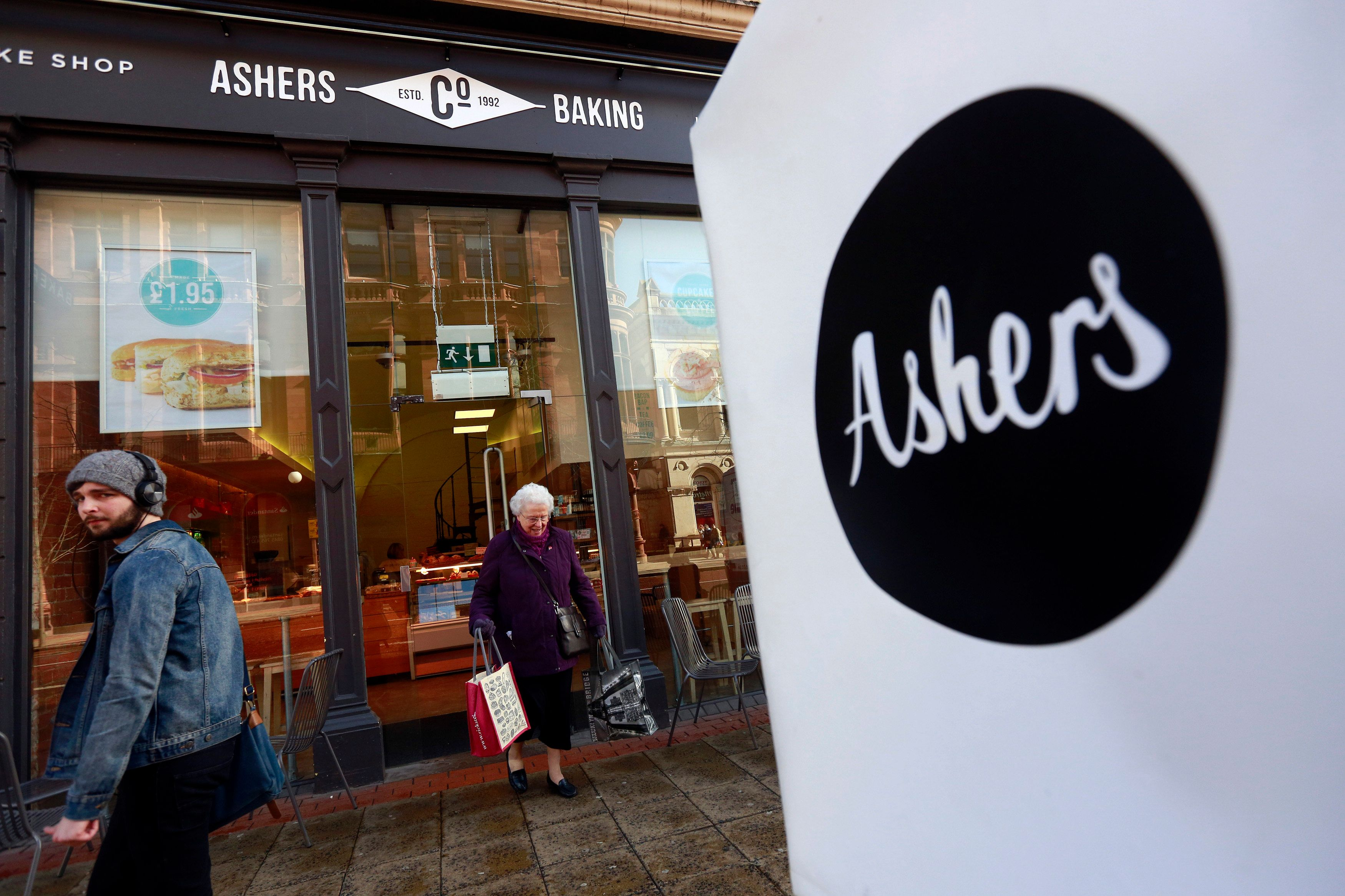 A woman leaves Ashers bakery in Belfast. March 26, 2015. Ashers is to face a discrimination case from the Equality Commission after it refused to make a cake bearing a pro-gay marriage slogan on it which was to be given to Andrew Muir, Northern Ireland's first openly gay mayor. The bakers refused to make the cake on the grounds that it contradicted their religious beliefs according to local media. REUTERS/Cathal McNaughton