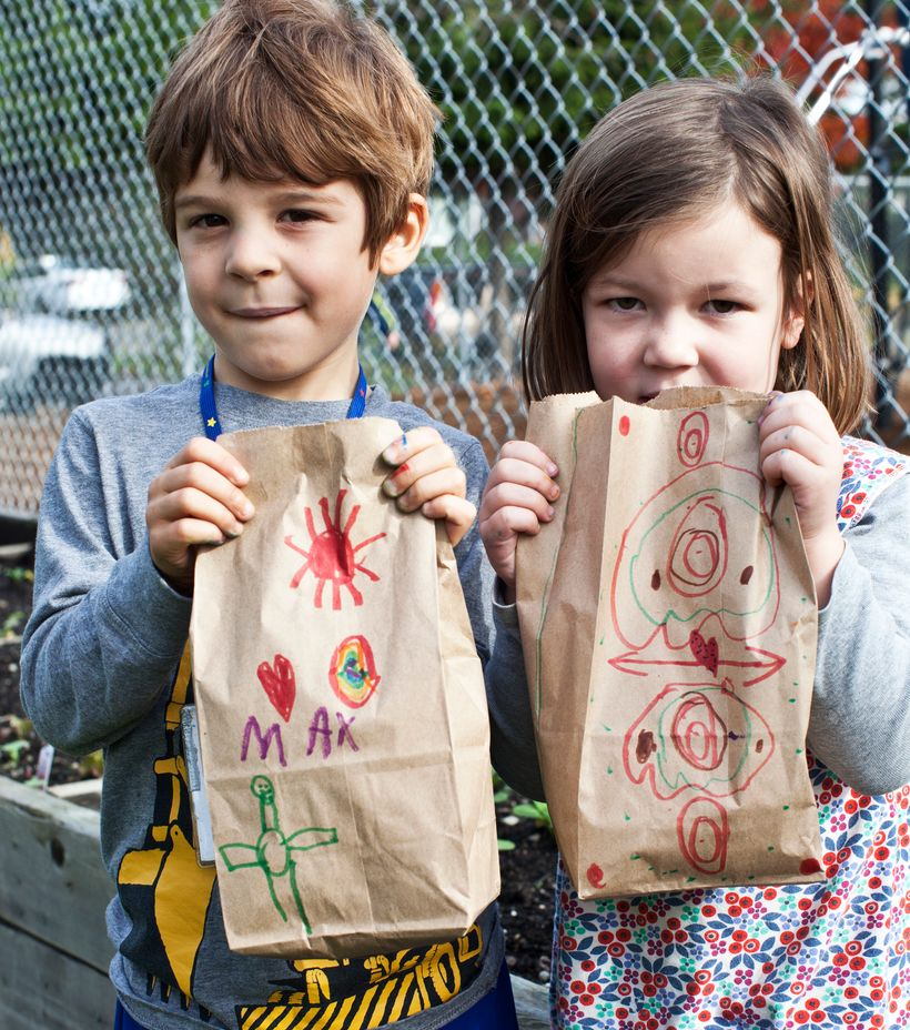 Max and Graecyn showing off their homelessness bags