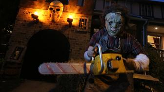 TORONTO, ON - OCTOBER 30:  Adam Campbell, 13 years old, dresses up as the character from  'The Texas Chainsaw Massacre' standing on his front lawn with a  halloween display that has become a neighbourhod tradition.        (Vince Talotta/Toronto Star via Getty Images)