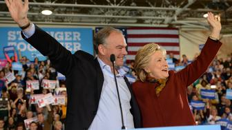 Democratic presidential nominee Hillary Clinton attends a campaign event with her running mate Tim Kaine on October 22, 2016, at Taylor Allderdice High School in Pittsburgh, Pennsylvania. / AFP / Robyn BECK        (Photo credit should read ROBYN BECK/AFP/Getty Images)