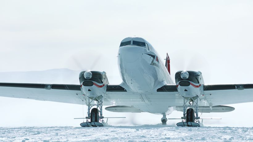 Living In The Age of Airplanes - an airplane departs Antarctica