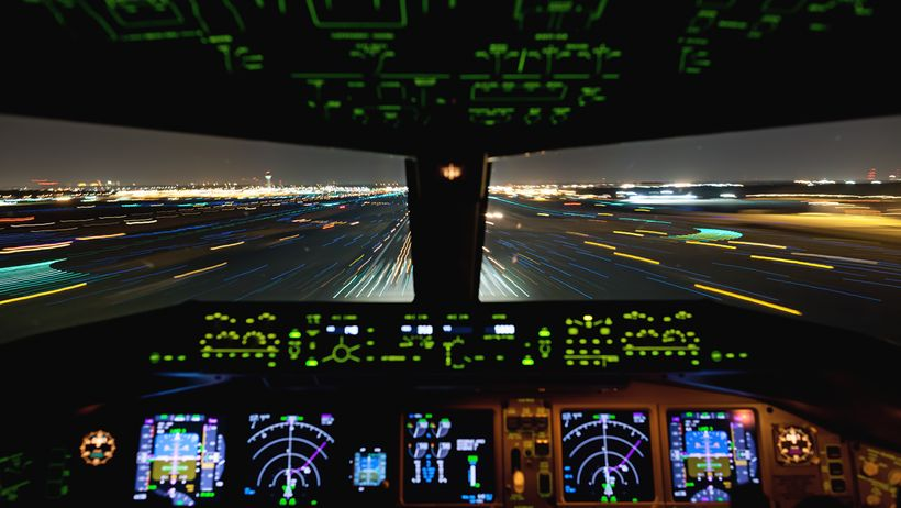 Living In The Age of Airplanes - a shot of the cockpit during a night landing
