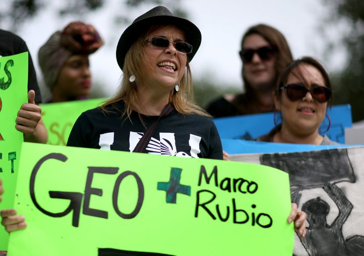 Protesters gathered in front of GEO Group headquarters in Boca Raton, Florida. The company made $150,000 in donations to