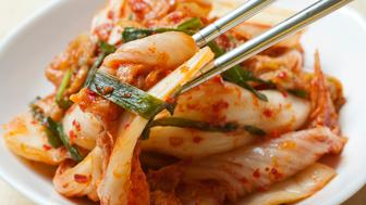 spicy kimchi, the Korean preserved vegetable dish with Napa cabbage and scallions