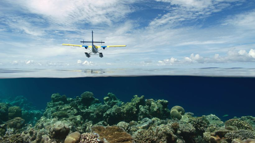 Living In The Age of Airplanes - A seaplane flyover in the Maldives