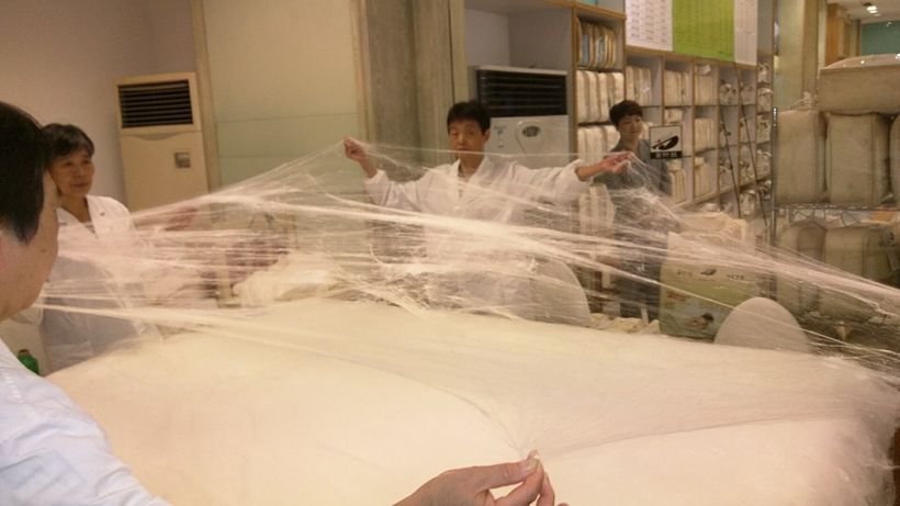 Quilt makers stretch each skein forming layers