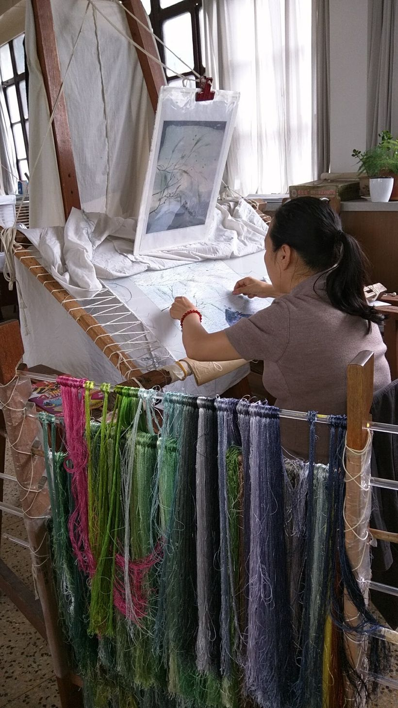 Masters create pictures from fine silk threads