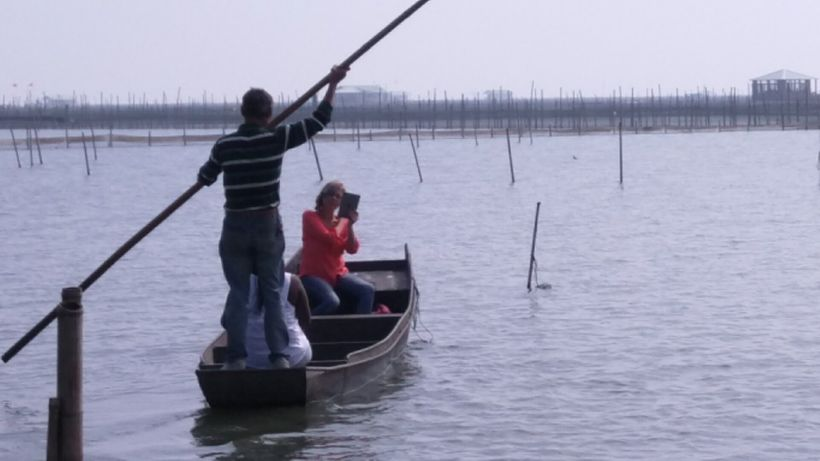 Visitors go out in boats to the crab cages