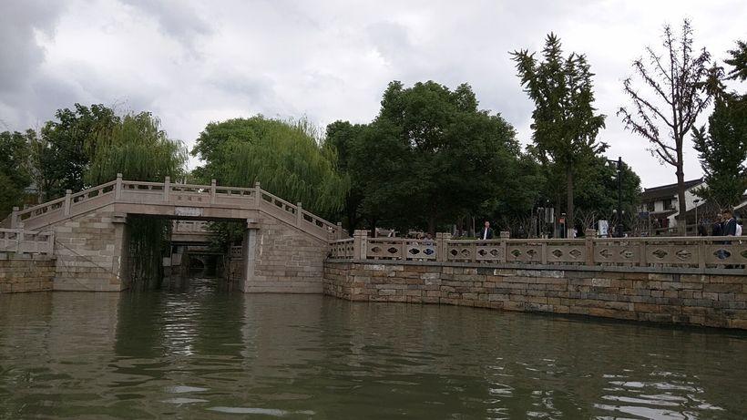 Stone bridges span the canals
