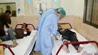 Medical workers treat an injured policeman at hospital after militants attacked the Balochistan Police College in Quetta on October 25, 2016. Heavily-armed Islamist militants wearing suicide vests stormed the Pakistani police academy, killing at least 44 people and wounding dozens more, officials said on October 25, in one of the deadliest extremist attacks this year. / AFP / BANARAS KHAN        (Photo credit should read BANARAS KHAN/AFP/Getty Images)